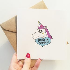 unicorn card in hand